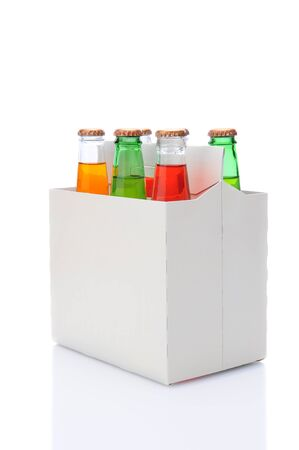 6 pack: Three quarters view of a six pack of assorted soda bottles over a white background with reflection. Stock Photo