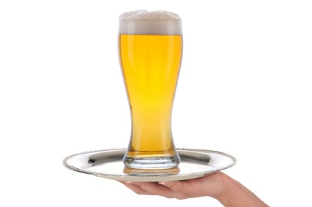 alcohol server: Waitresses hand and arm holding a silver serving tray with a glass of beer. Vertical format over a white background. Stock Photo