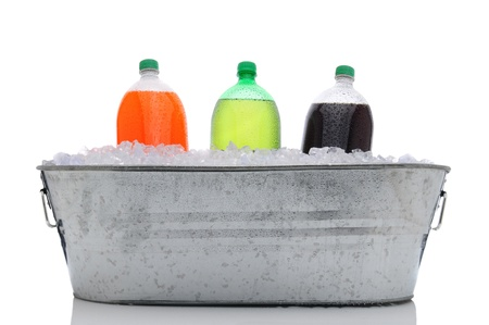 Party bucket filled with ice and three two liter soda bottles. Orange, lemon lime and cola plastic bottles with condensation in horizontal format over a white background and reflection. Stock Photo - 12595884
