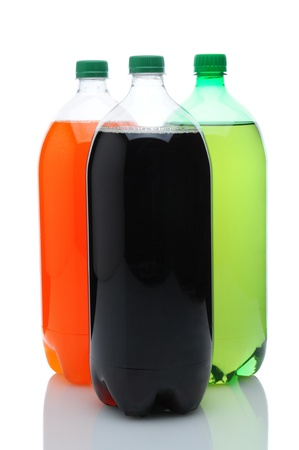 Three plastic two liter soda bottles with reflection. Vertical format over a white background.