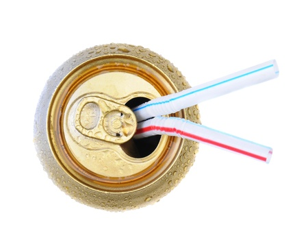 Two Drinking straws in an open soda can. Top view over white. Stok Fotoğraf