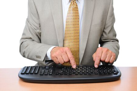 Closeup of a Businessman typing on a wireless keyboard. Man is seated at a desk and is unrecognizable. Horizontal format over white. Banco de Imagens