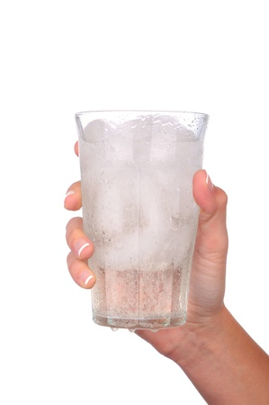 Closeup of a woman's hand holding a cold glass of water and ice over a white background Stock Photo - 12596991