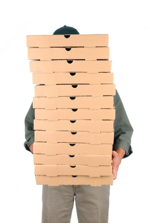 A Pizza Deliveryman hidden behind a large stack of boxes he is carrying. Vertical format over white. Imagens