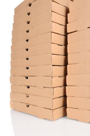 Two large stacks of pizza boxes over a white background. Stock Photo