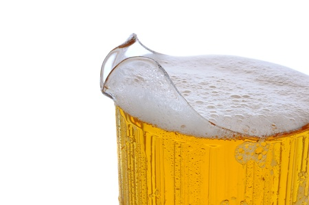 Closeup of a full Beer pitcher over a white background.