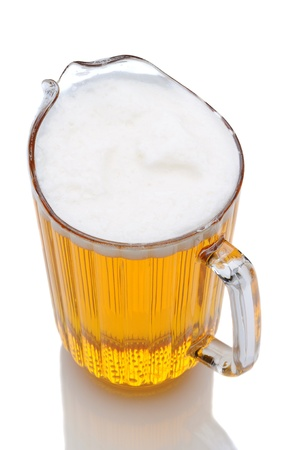 A pitcher of beer shot from a high angle over a white background with reflection. Stock Photo - 12853741