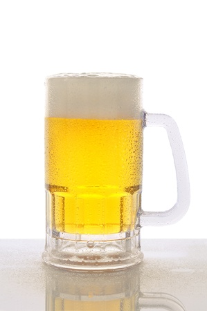 A cold frosty mug of beer on a wet bar counter top with a white background. Vertical format with reflection.. Stock Photo - 12853743