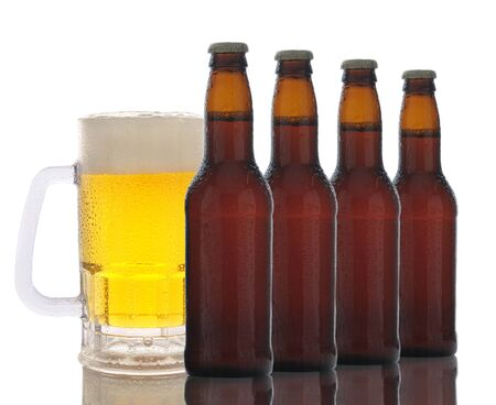 A frosty mug of beer behind a row of brown beer bottles. Horizontal format over white with reflection. Stock Photo - 12853746