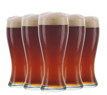 Five dark frosty beer glasses arranged over a white background. Stock Photo - 12853782