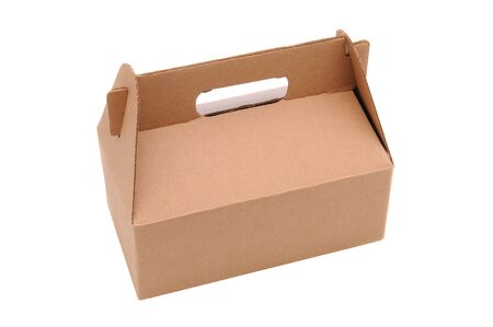 A Cardboard Carry our box with handle isolated over a white backgorund. Zdjęcie Seryjne