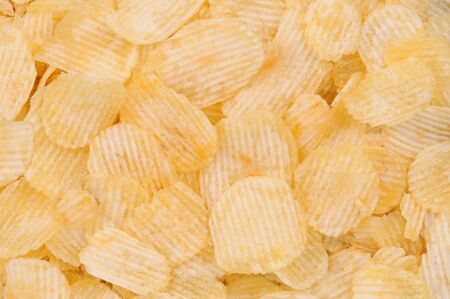 crinkle: Closeup of Crinkle Cut Dip Potato Chips, fills the frame. Stock Photo