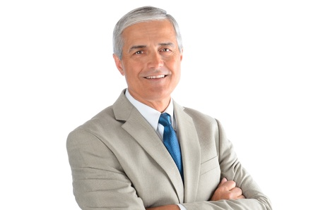 Portrait of a smiling middle aged businessman wearing a light tan suit with a blue necktie and his arms crossed. Horizontal over a white background. photo