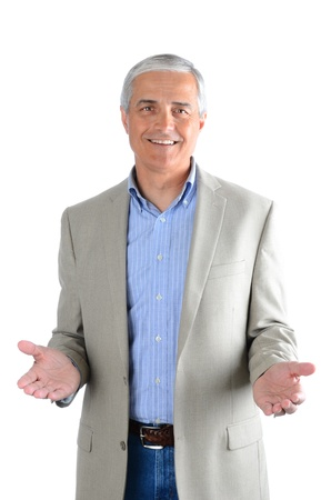 1 mature man: Portrait of a casual middle aged man wearing blue jeans, dress shirt and a sport coat. Man has both hands extended in front of himself over a white background. Stock Photo