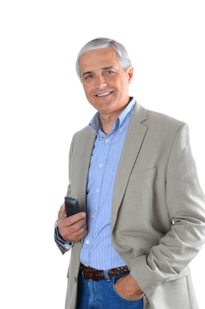 experiencing: Mature businessman in casual attire holding a cell phone.