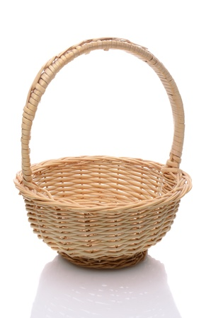 interleaved: Round wicker basket with handle isolated on a white background with slight reflection.