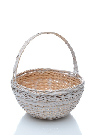 interleaved: Round white wicker basket with handle isolated on a white background with slight reflection.
