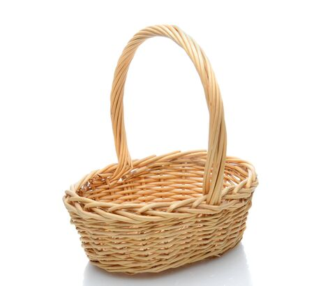 Oval wicker basket with handle isolated on a white background with slight reflection.