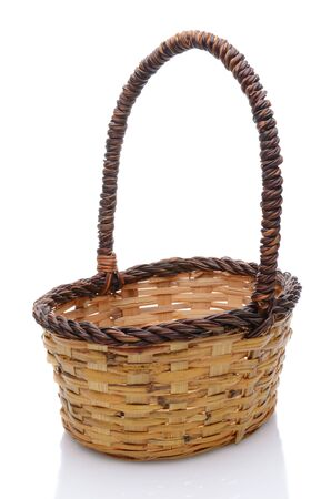 splice: Oval wicker basket with handle isolated on a white background with slight reflection.
