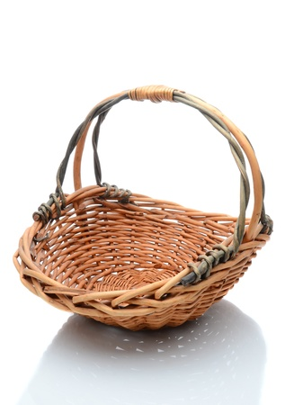 splice: Oval wicker flower basket with handle isolated on a white background with slight reflection. Stock Photo