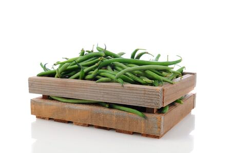 Wooden Produce crate filled with green beans. Horizontal format over a white background with reflection. Stock Photo - 13996422