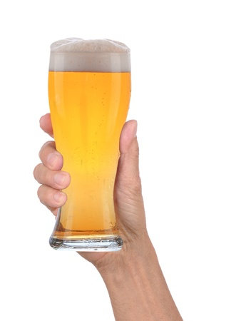 Closeup of a male hand holding up a glass of beer over a white background. Vertical format with condensation side of the beer glass. Imagens