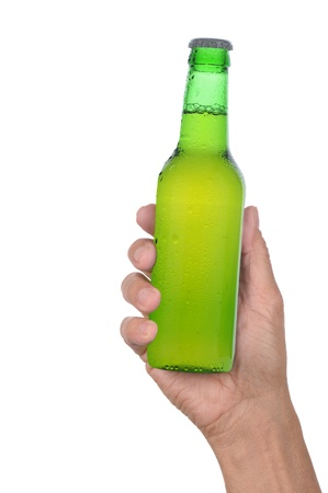 holding close: Mans hand holding up a green beer bottle without label over a white background vertical format