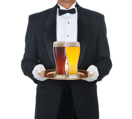 Butler Wearing Tuxedo Holding Tray with two full beer glasses. Square format isolated on a white background. photo