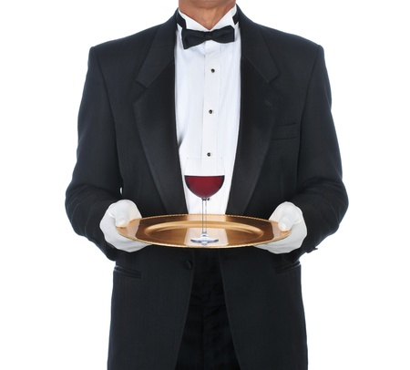 butler: Waiter Wearing Tuxedo Holding Tray with a glass of red wine. Square Format over a white background. Stock Photo