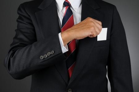 breast pocket: Closeup of a businessman reaching into his breast pocket to get a business card Stock Photo