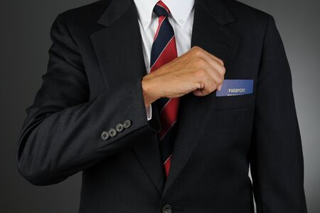 breast pocket: Closeup of a businessman reaching into his breast pocket to get his passport