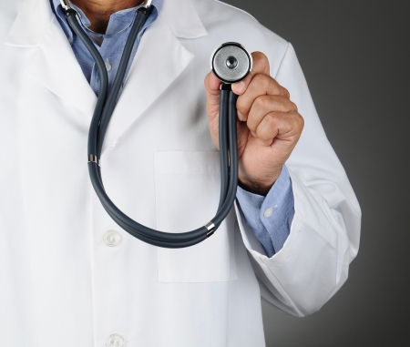 Closeup of a doctor holding up a stethoscope photo