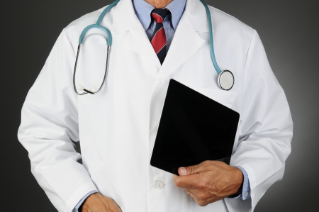 Closeup of a doctor holding a tablet computer