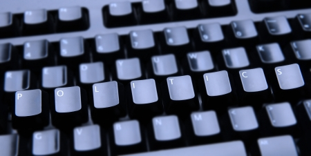 keyboard: The word Politics spelled out on a computer keyboard. Only the keys forming Politics are in focus.