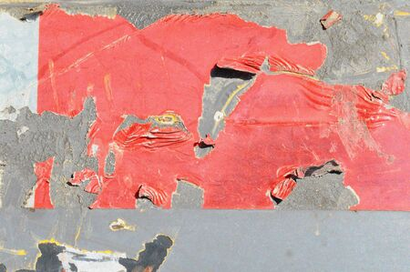 Closeup of red peeling paint on an industrial machine  Stock Photo
