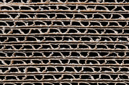 Macro shot of the ends of a stack of corrugated cardboard boxes, Horizontal format. Zdjęcie Seryjne