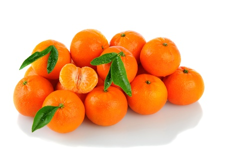 reticulata: A pile of Clementine Mandarin Oranges. Horizontal format over a white background with reflection. Stock Photo