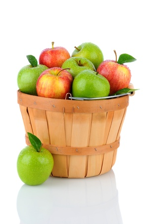 granny smith: A basket of fresh picked Gala and Granny Smith Apples. Vertical format over a white background with reflection.