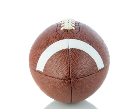 american: A closeup end view of an American Football on a white background with reflection.