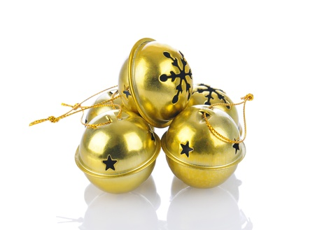 jingle bell: A group of jingle bells on a white background with reflection.