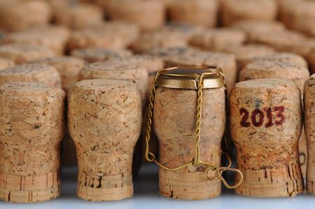 Closeup of a large group of Champagne corks, that fill the frame. Selective focus on the front row. One cork has the date 2013 stamped on it and another has the metal cage. Horizontal format. Stock Photo