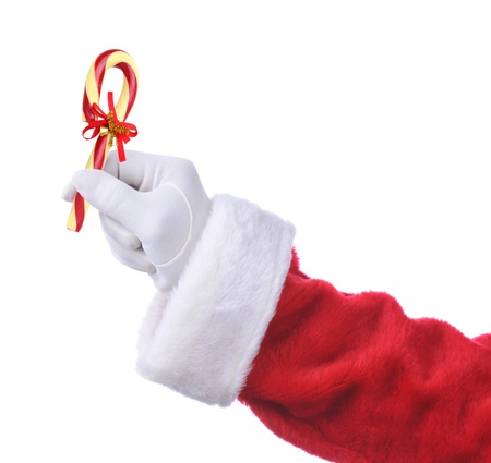 st  nick: Santa Claus hand holding an Old Fashioned Candy Cane with a ribbon and bells. Isolated on white, hand and arm only.
