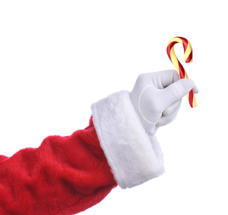 hand: Santa Claus hand holding an Old Fashioned Candy Cane. Isolated on white, hand and arm only.