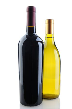 vertical format: Close up of a cabernet sauvignon and chardonnay wine bottles on a white background with reflection. Chardonnay bottle is tucked behind the Cabernet bottle. Vertical Format.