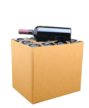 Closeup of a case of wine with one bottle resting on top. Isolated on white. photo