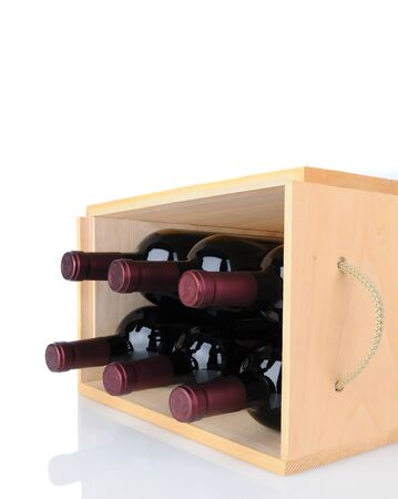 vertical format: Closeup of six Cabernet Sauvignon wine bottles in a wooden crate laying on its side. Vertical format isolated on white with reflection. Stock Photo