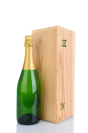 A Champagne bottle in front of a wood gift box. Vertical Format isolated on white with reflection. photo
