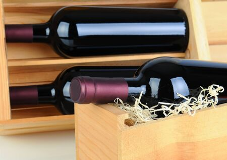 Closeup of red wine bottles in wood crates. Shallow depth of field. photo