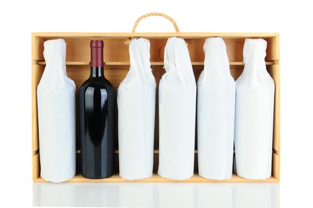 Six tissue wrapped wine bottles in a wooden crate with rope handle. Horizontal format isolated on white with reflection. One bottle is not wrapped. photo