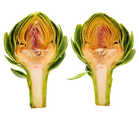 Two halves of the same artichoke misted with water and isolated on white. photo